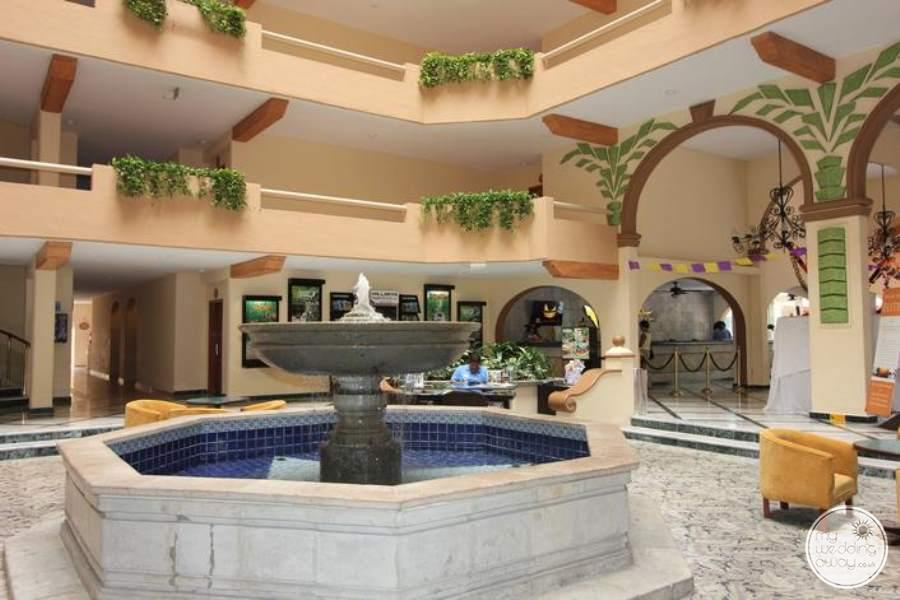 Main lobby area with water fountain and view of the rooms