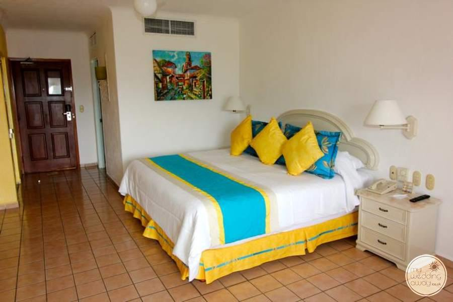 Master Suite With beautiful yellow and blue Decor and tile floors