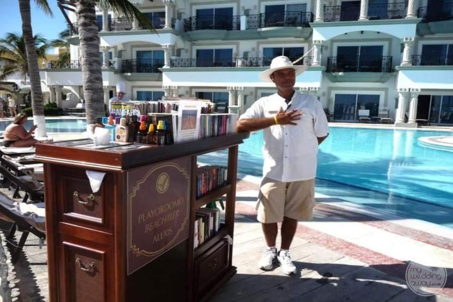 Royal Playa del Carmen Poolside Books and Sunscreen
