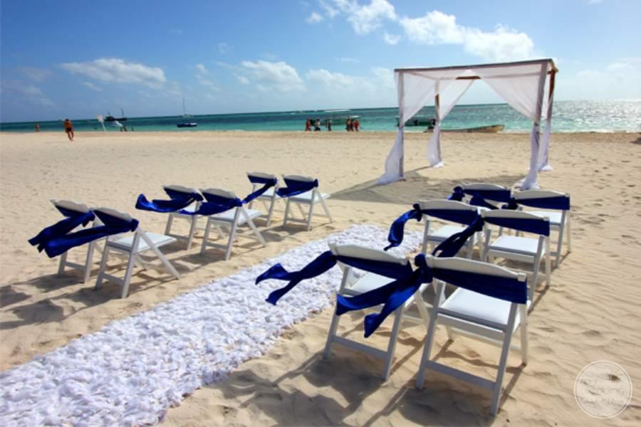 Outdoor beach ceremony  venue with chairs on the sand