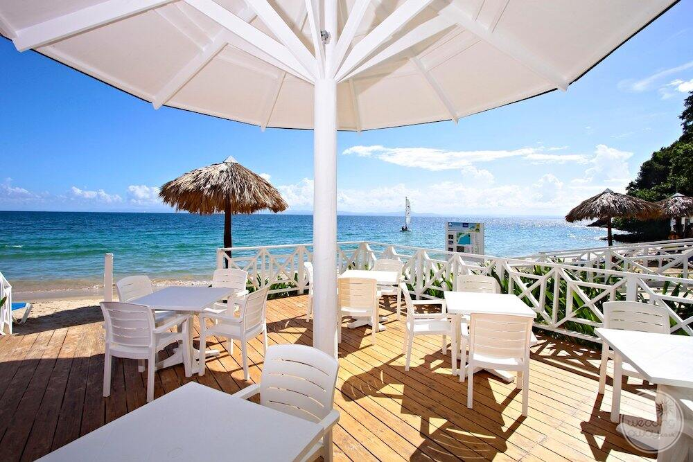 Outdoor dining area on patio overlooking the caribbean ocean
