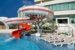 Beach-Palace-Waterslide-and-Lounge-Chairs