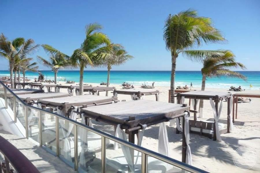 cabana beach bed is located on the white sand beach by the blue ocean