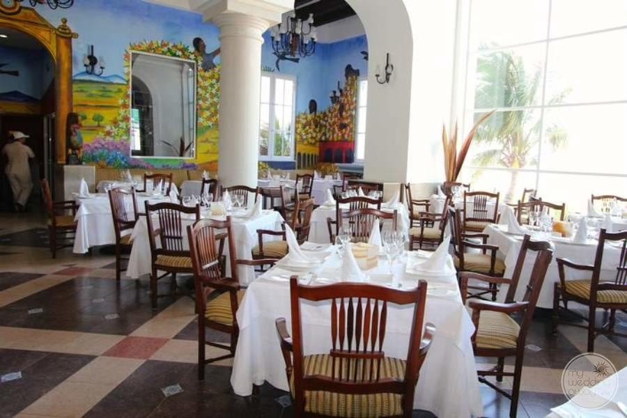 Italian restaurant with Val fresco painting white table linen and marble floors