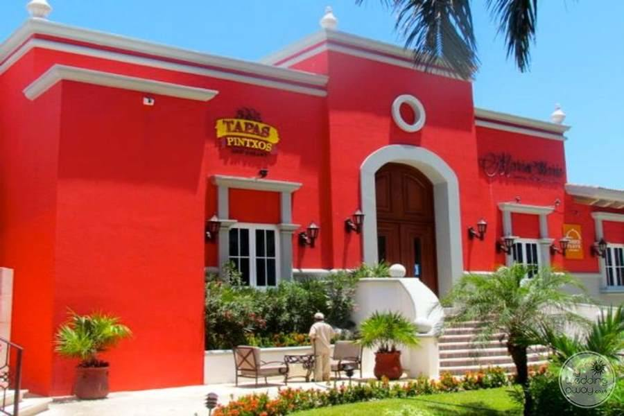 main tapas Mexican restaurant and red paint with large wooden door