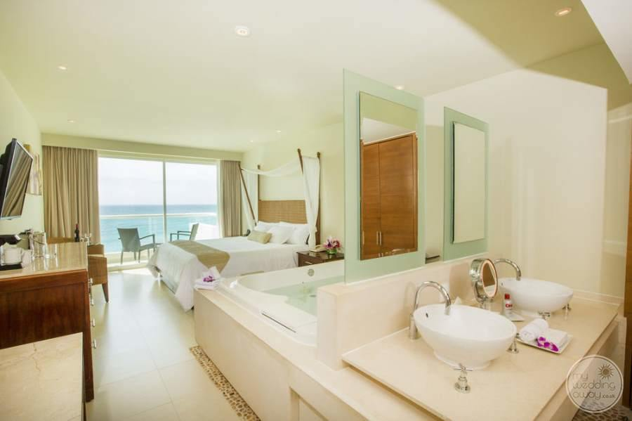 King ocean view room with a double Jacuzzi and double sink vanity is