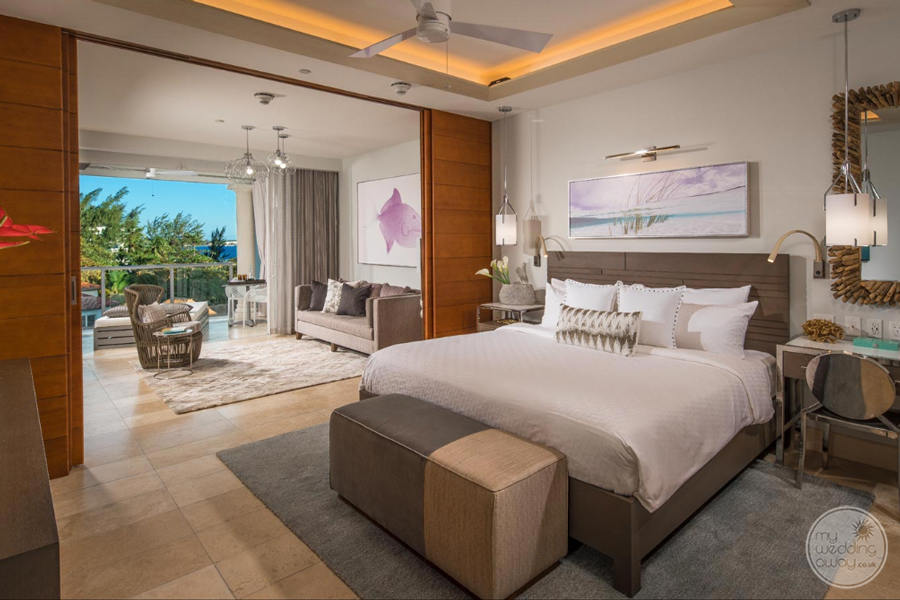 King Room with open couch area and view of gardens and ocean