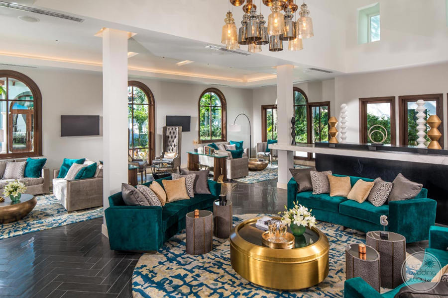 Lobby Lounge with plush green velvet couches and tile flooring