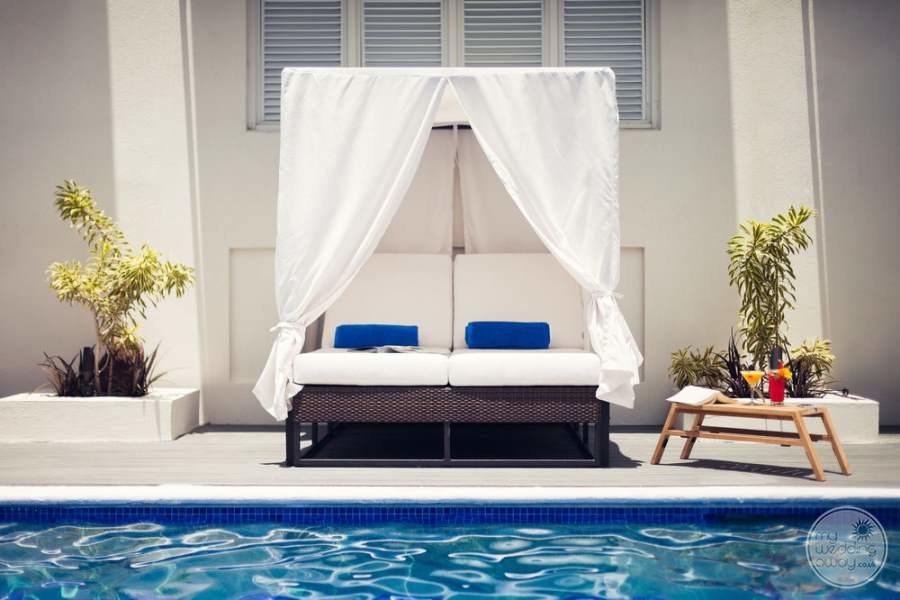 outdoor white double date bed with covering and Terrace beside the pool