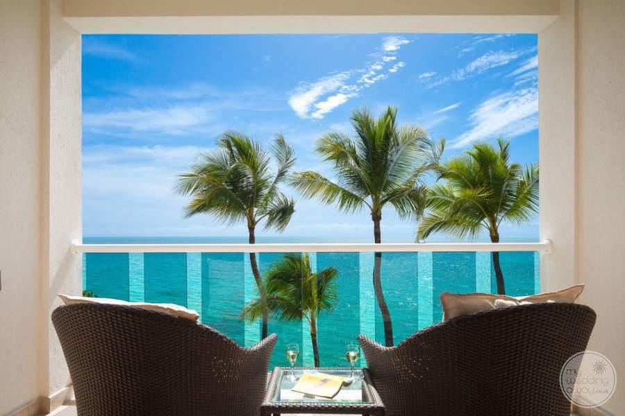 View of ocean from seated chairs inside lobby area