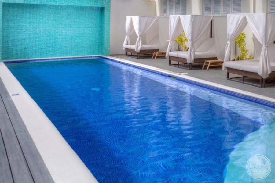 swimming pool outdoors with Day beds and white cushion