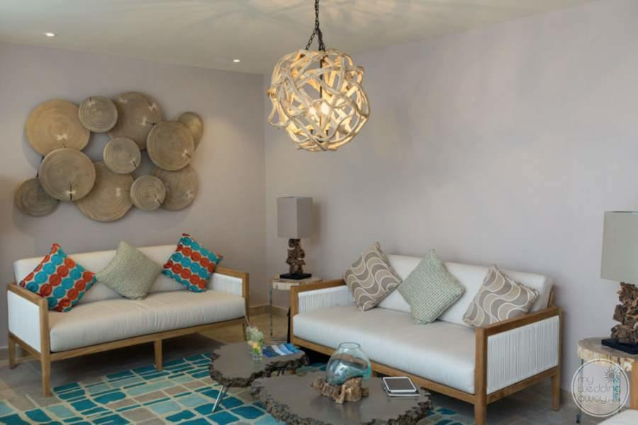 in resort seating with the white couches different colored pillows an art deco on the walls