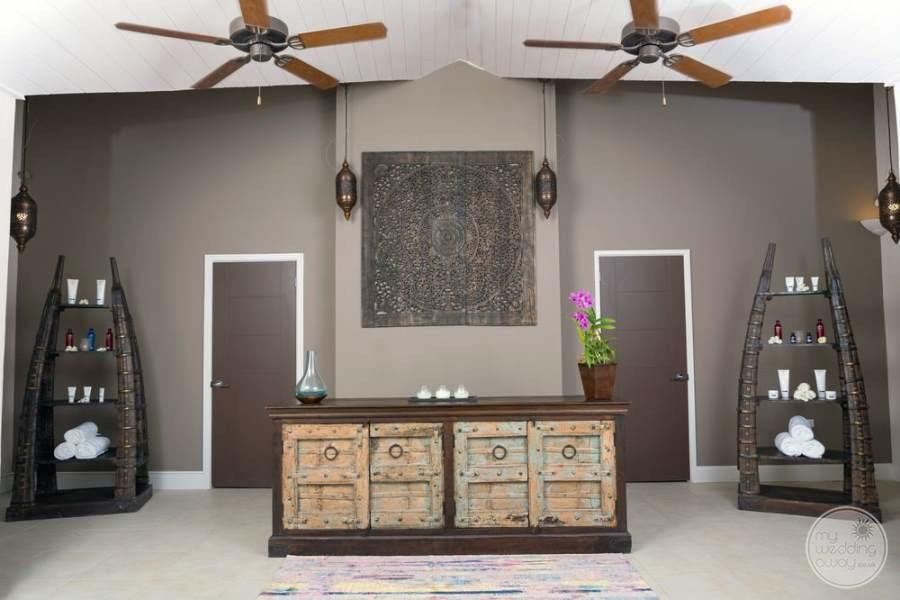 main spa area with beautiful Decour ceiling fans and art deco desk