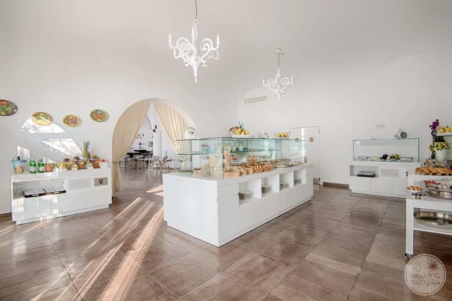 main buffet with beige tiling white Decour and pastries and desserts ready for eating