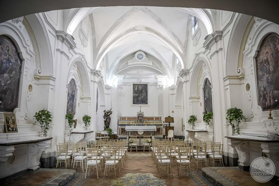 stunning white hi Reese ceiling white chapel with large area for seating for wedding ceremonies