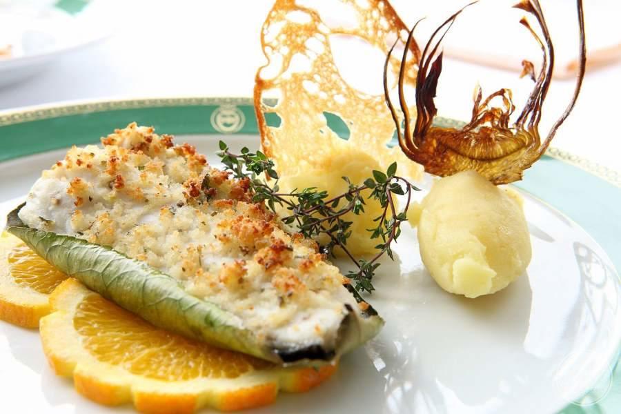 delicious entrée served over orange rind with potato mash