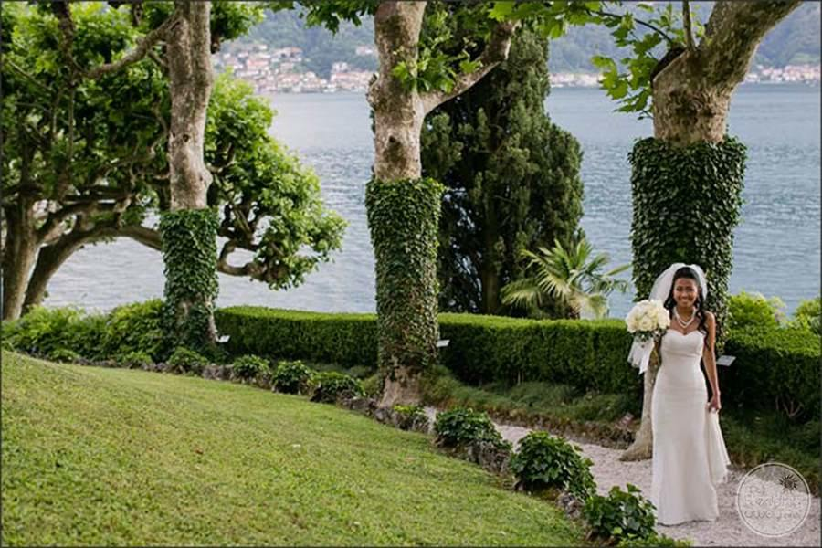 Beautiful bride walking along the manicure grounds On a pathway
