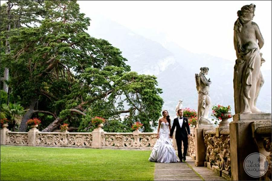 Wedding Couple Walking on the grounds looking at the statues