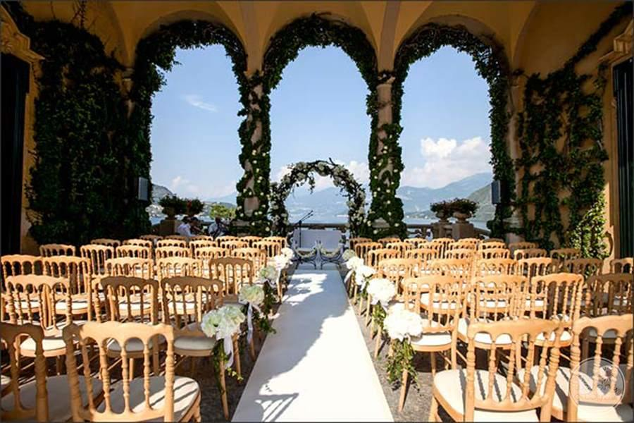 Sera Moni venue with a beautiful arched decorations and Flower decorated chairs