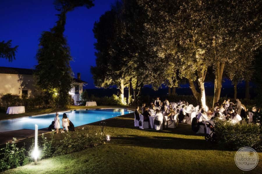 Evening Wedding Reception under hotel trees