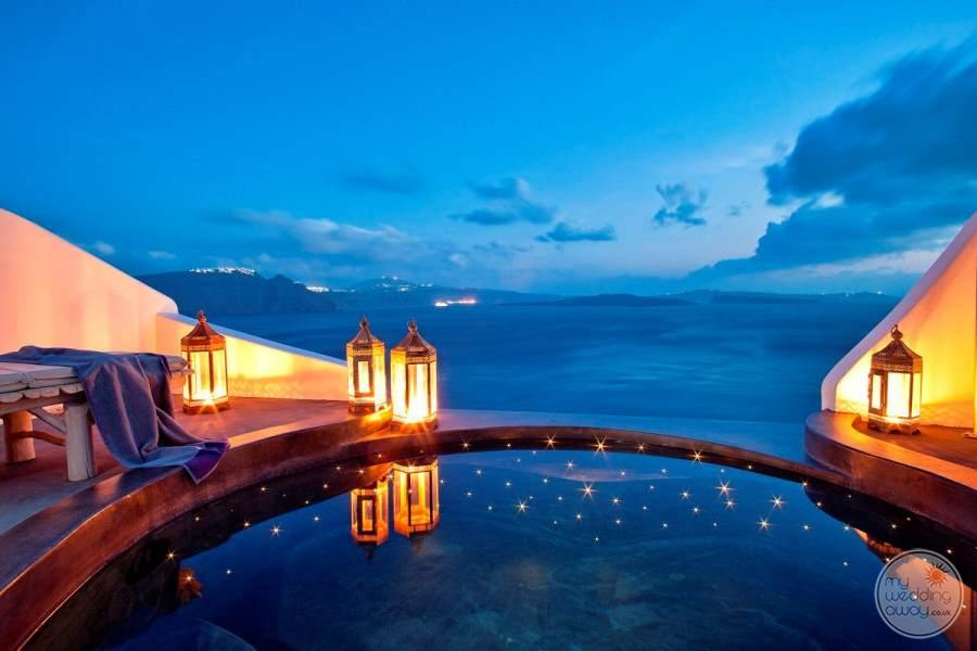 View of small infinity pool and ocean at night