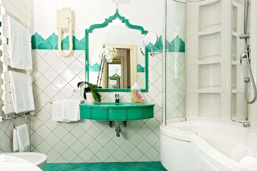 bathroom large soaker white Bathtub with green sink