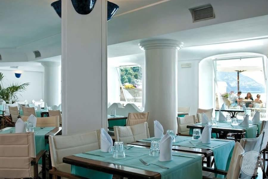 indoor Dining with light blue table decor and white columns.