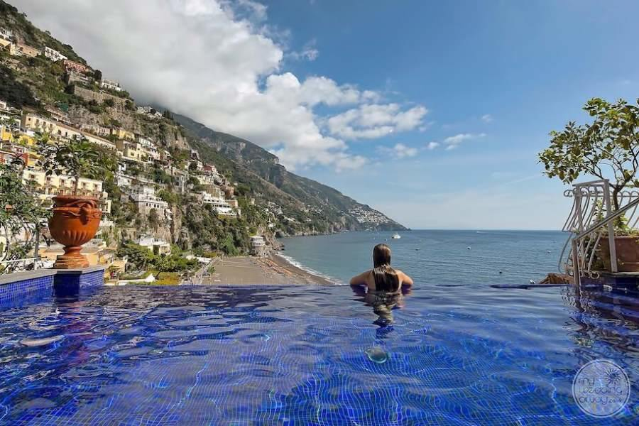 Infinity Pool overlooking the ocean and homes on the cliffs
