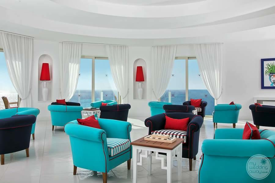 blue teal chairs with red pillows in  Lounge Area