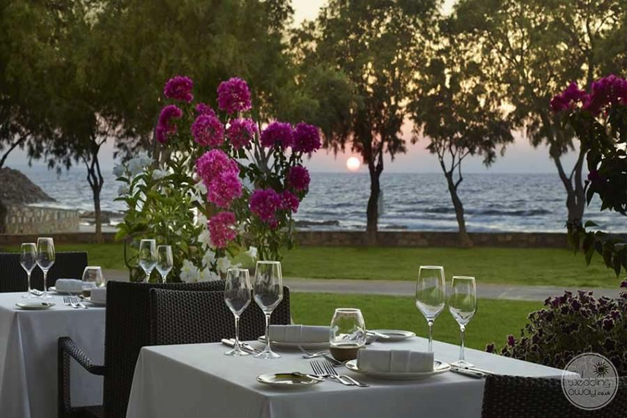 outdoor Dining with flower table at sunset