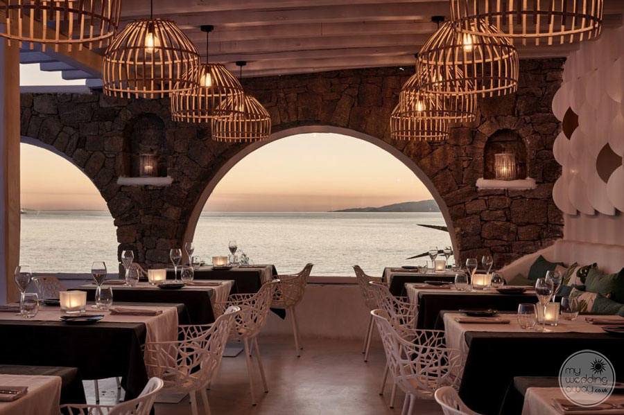 Dining Area with wood frame lighting and view of the ocean