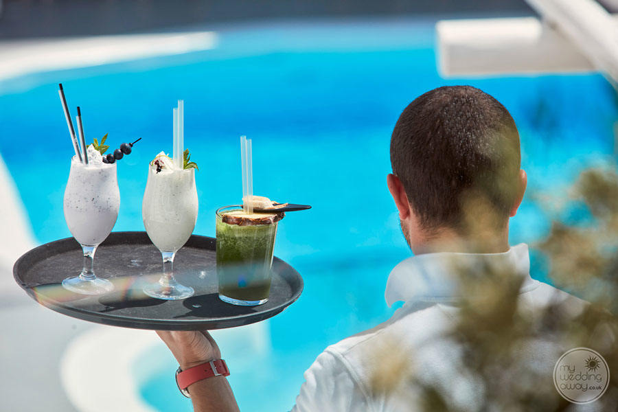 serving ice cold Cocktails by the Pool