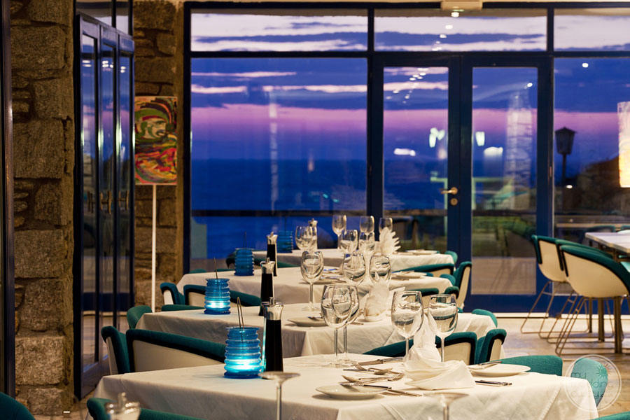 Evening Dining room with view of water at night