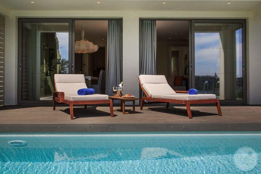 Pool Lounge Chairs outside private swim out rooms
