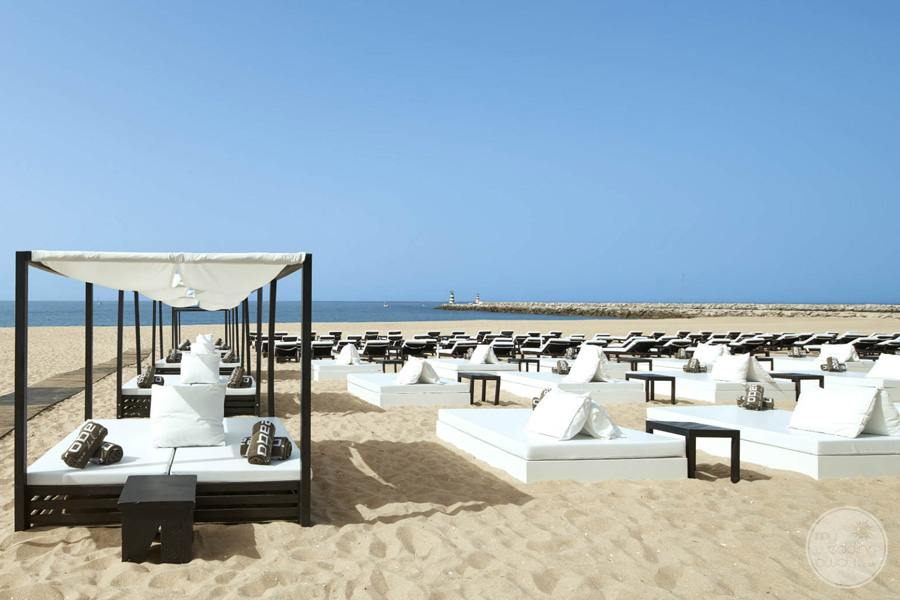 Anantara Vilamoura loungers and beach area