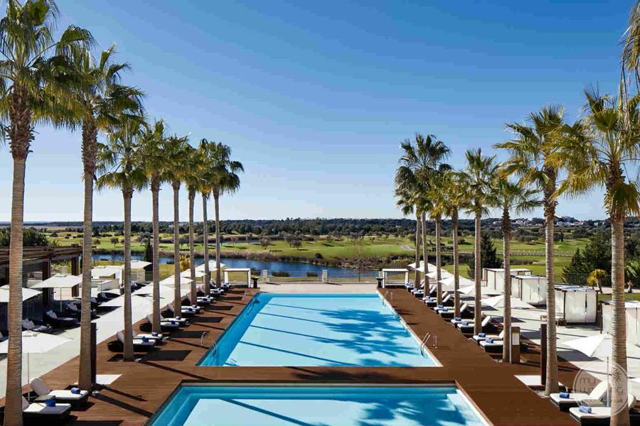 Anantara Vilamoura pool areaa and lounge chairs