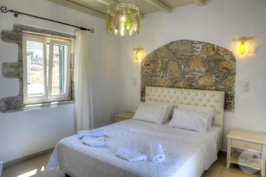 bedroom with chandelier lighting and rock headboard