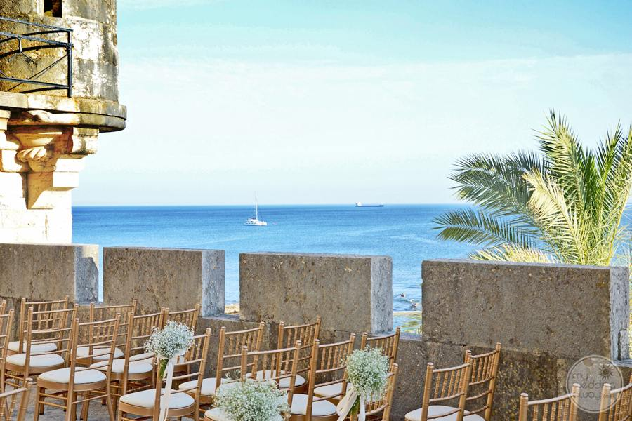 terrace wedding ceremony set-up with oceanview