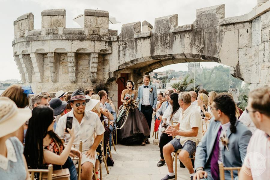 outdoor wedding ceremony by side of the castle