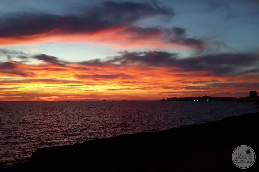 beachfront and ocean at dusk