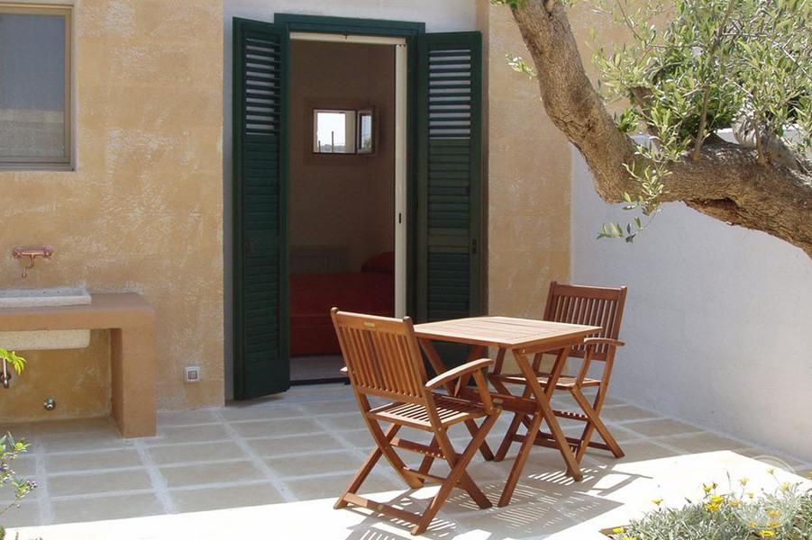 Masseria L'Antico Frantoio Hotel bedroom terrace table and chairs