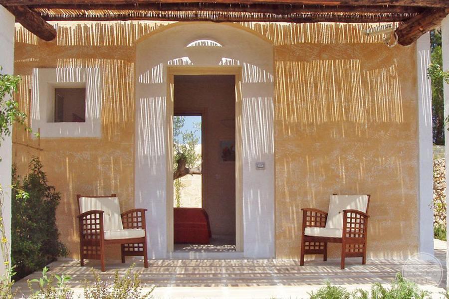 Masseria L'Antico Frantoio Hotel exterior bedrom porch sitting area