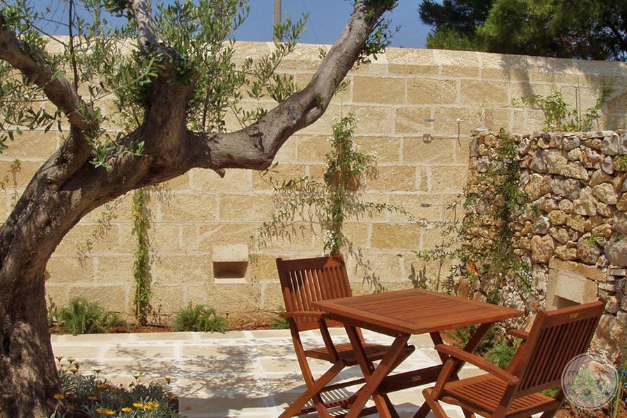 Masseria L'Antico Frantoio Hotel relaxing terracw with tree chairs and table