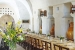 Masseria-L'Antico-Frantoio-Hotel- restaurant-dining-tables-with-flower-centerpieces