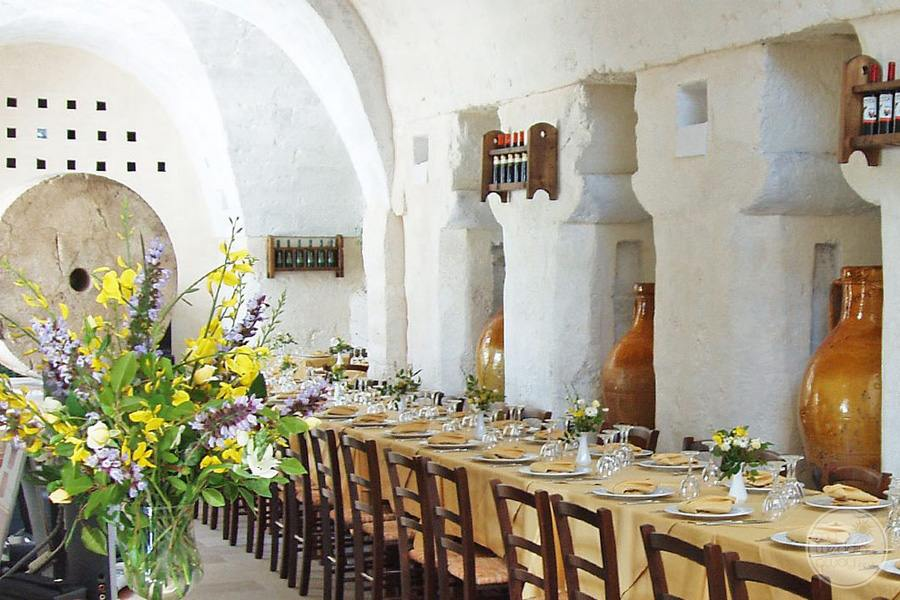 Masseria L'Antico Frantoio Hotel restaurant dining tables with flower centerpieces