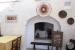 Masseria-L'Antico-Frantoio-Hotel-restaurant-fireplace-around-tables