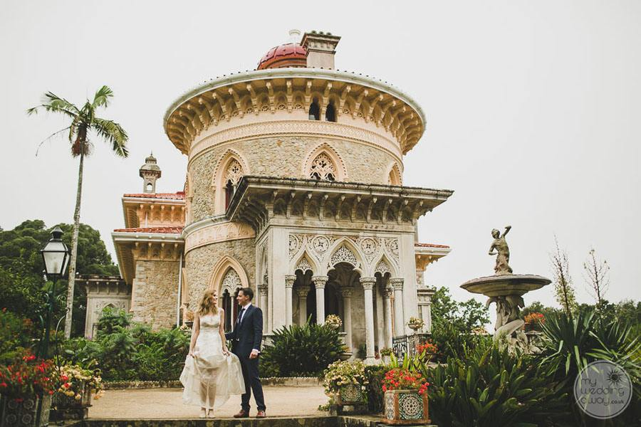 Wedding couple in outside gardens taking wedding photograph