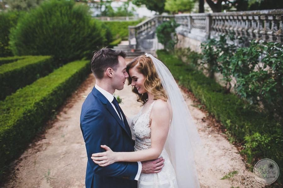 wedding couple in garden area embracing