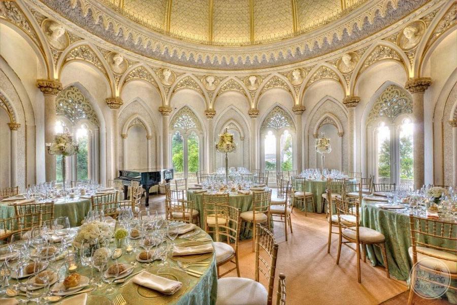 inside wedding reception room with mint green reception decor