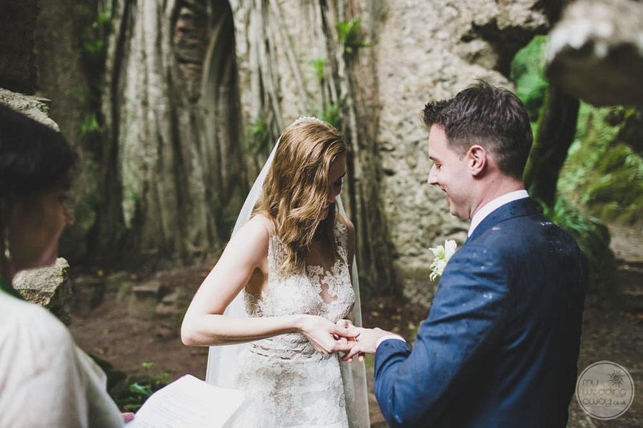 oustide ceremony ring exchange between bride and groom